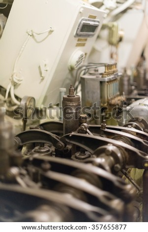 Old diesel engine inside of submarine.