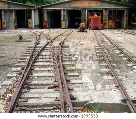 Old Diesel Train Repair Shed -- vintage Japanese built narrow tracks - stock photo