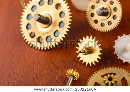 Old different gears on the table - stock photo