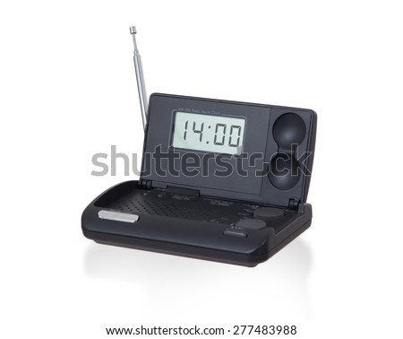 Old digital radio alarm clock isolated on white - Time is 14:00 - stock photo