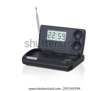 Old digital radio alarm clock isolated on white - Time is 22:59 - stock photo