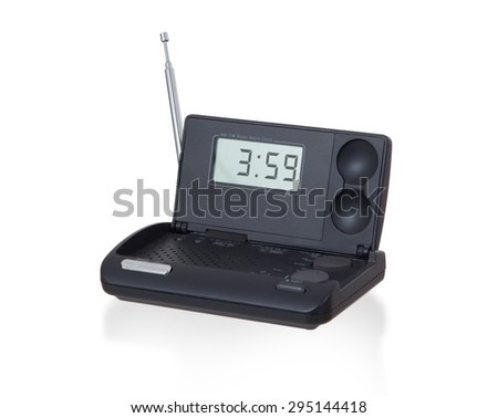 Old digital radio alarm clock isolated on white - Time is 3:59 - stock photo