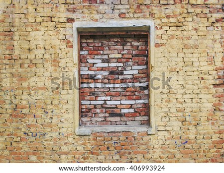 Old dilapidated brick wall with window. Vintage background. - stock photo
