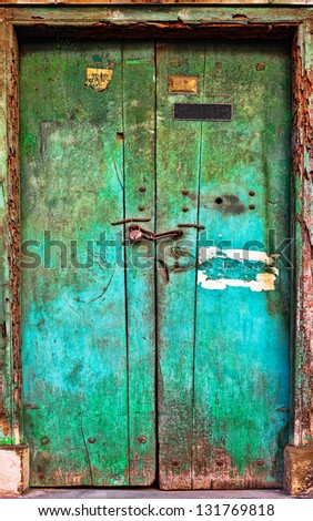 Old dilapidated wooden door. Rajasthan, India, Asia. Background - stock photo