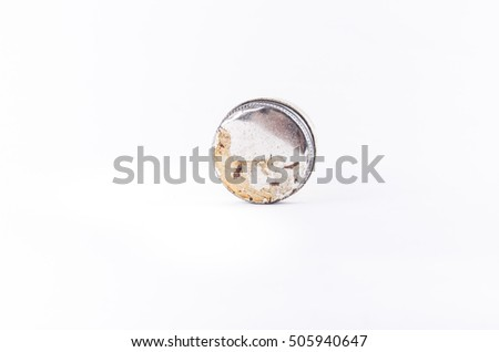 Old dirty aluminium lid or jar cap isolated on white background. Template for work and education.