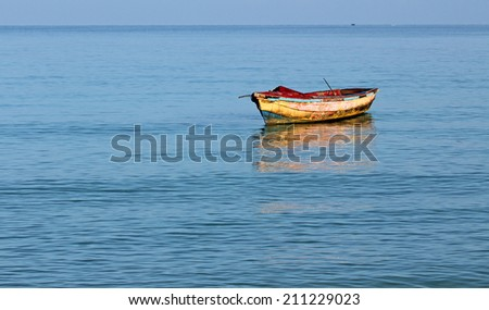 Old dirty angler's boat on Caribbean Sea , Jamaica