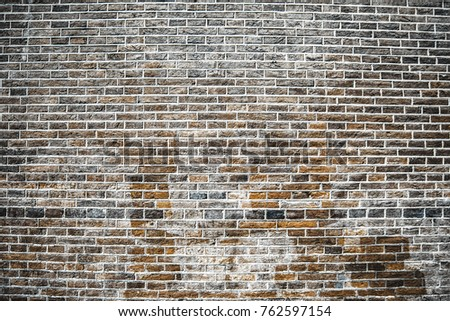 Old dirty brick wall outside the building for the background.