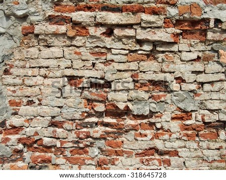 old dirty brick wall, vintage background - stock photo