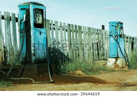 Old dirty gas stations - stock photo