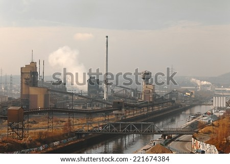 Old, dirty industrial district with smog - stock photo