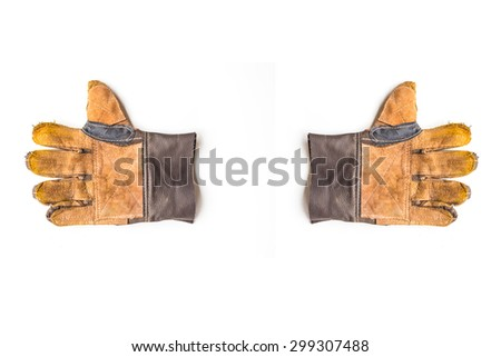 Old Dirty Leather Work two gloves Isolated On White