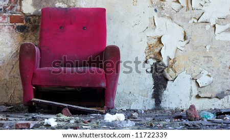 Old dirty pink chair - stock photo