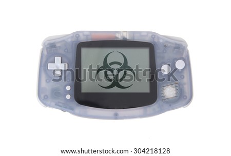 Old dirty portable game console with a small screen - biohazard symbol - stock photo