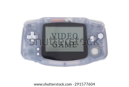 Old dirty portable game console with a small screen - video game - stock photo