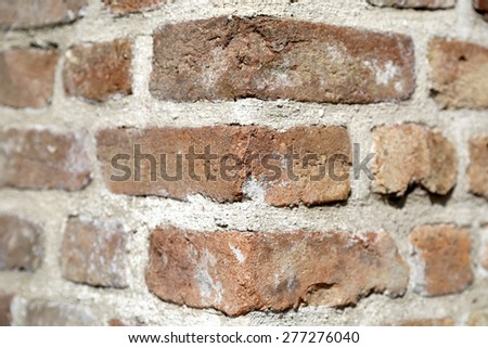 Old dirty red and tan brick wall background texture with copyspace - stock photo