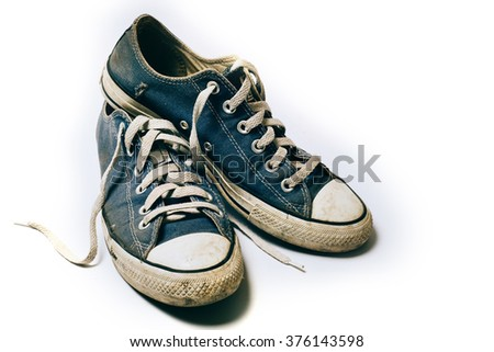 Old & dirty shoes isolated on white background - stock photo