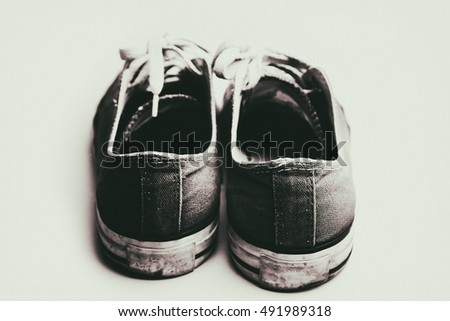 Old & dirty shoes isolated on white background vintage sepia photogrphy coloring