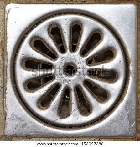 Old dirty shower drain close-up - stock photo