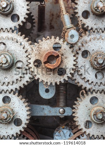 Old dirty weathered cogwheels of an industrial machine