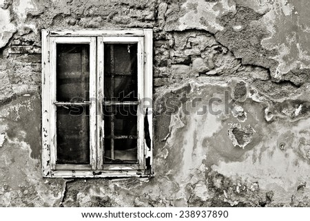 Old dirty window on old dirty wall / Window / Damaged building - stock photo