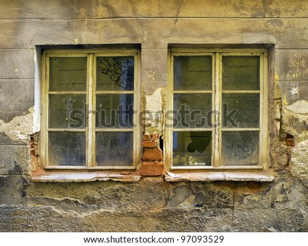 old dirty windows on old dirty wall