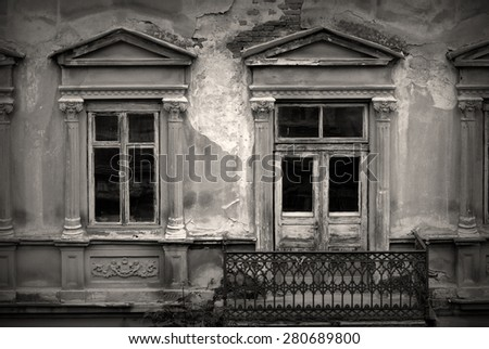old dirty windows on old dirty wall. black and white photo - stock photo