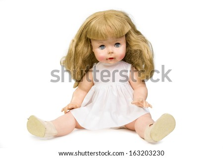Old doll isolated on white - stock photo