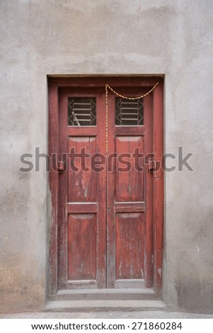 Old door and window of old cottage in Nepal - stock photo