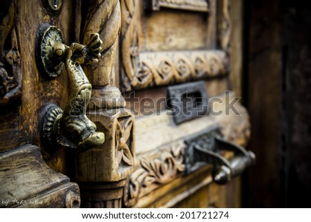 Old door handle - stock photo