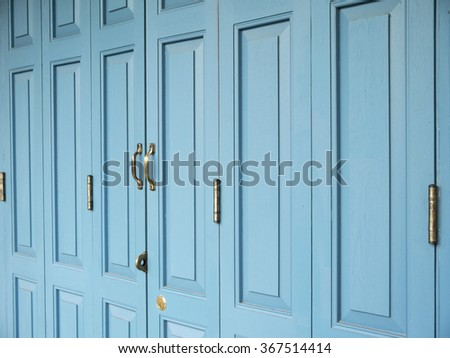 Old Door handles with an old double door painted with blue - stock photo