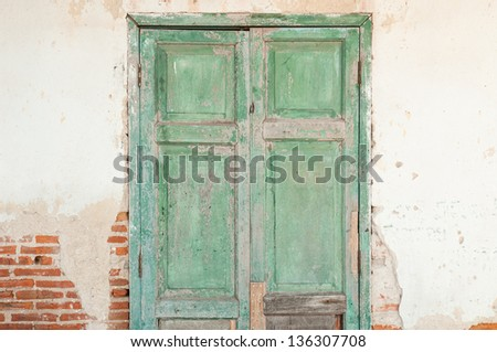Old door in a crumbling building