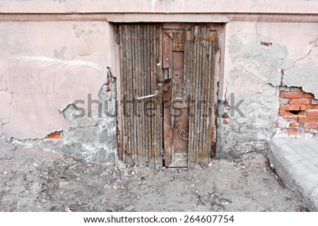 Old door in stone wall in Astrakhan Russia - stock photo