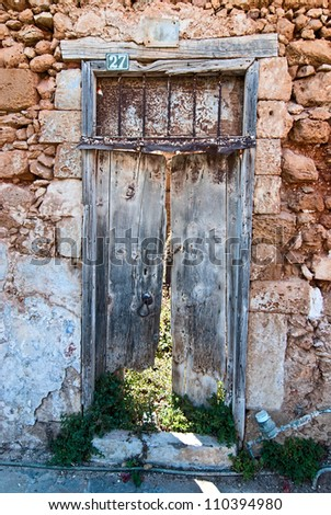 Old door in the winding alleys of the city of Chania. Crete. - stock photo