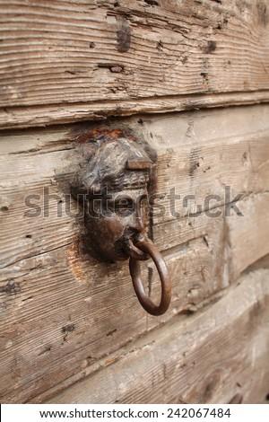 old door knob on an old wood door  - stock photo