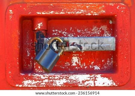 Old door locked with rusty padlock closeup photo - stock photo