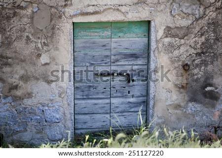 old door of an ancient farm - stock photo