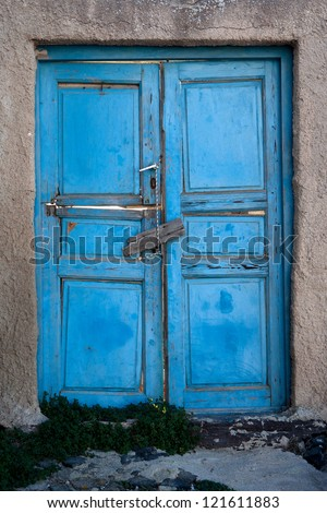 Old door of blue color. Santorini Island, Greece