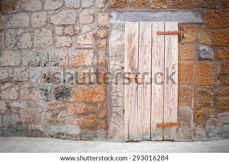 Old door of cellar in the old style of medieval village