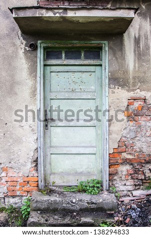 old door on a  brick building