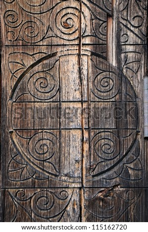 Old door Part of an old wooden door with ornaments - stock photo