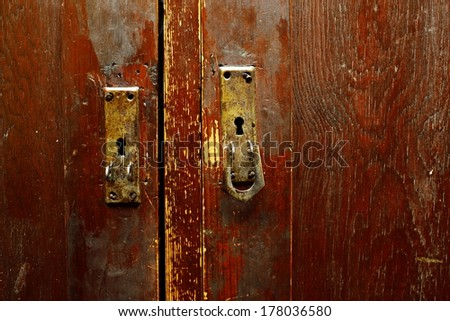 old door with handles and locks - stock photo