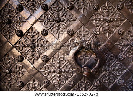 Old door with ornament in stone wall, Royal Wawel Castle, Poland. - stock photo
