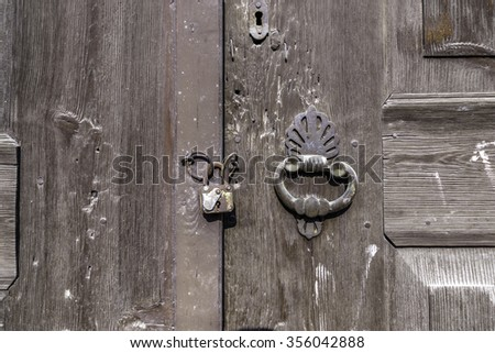 Old door with ring knocker - stock photo