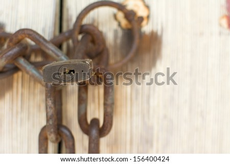 Old door with rusty lock and chain, closeup - stock photo