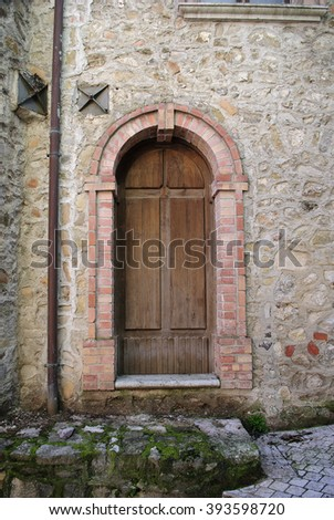 Old door with wood and stone