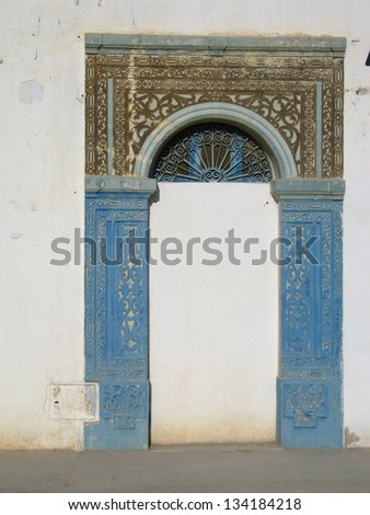 Old doors in Tunisia with blue details - stock photo