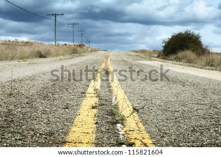 Old dramatic asphalt road. - stock photo