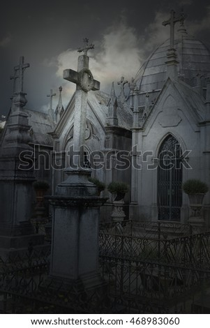 Old dramatic cemetery in a cloudy evening
