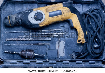 old drill and drill bits are in the box.view from above - stock photo