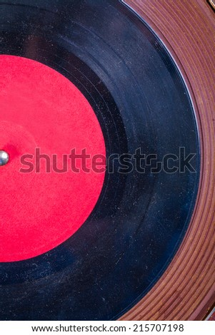 Old dusted vinyl record on Turntable very close up view - stock photo